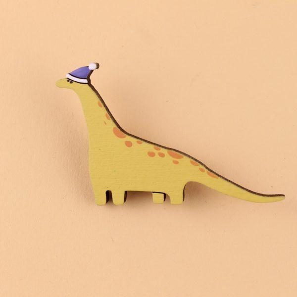 Значок Динозавр в новогодней шапочке